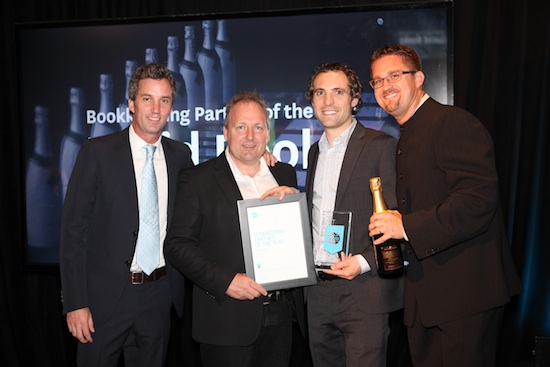 Lucid Books accepts an award from Xero employees Jamie, Rod and Ian